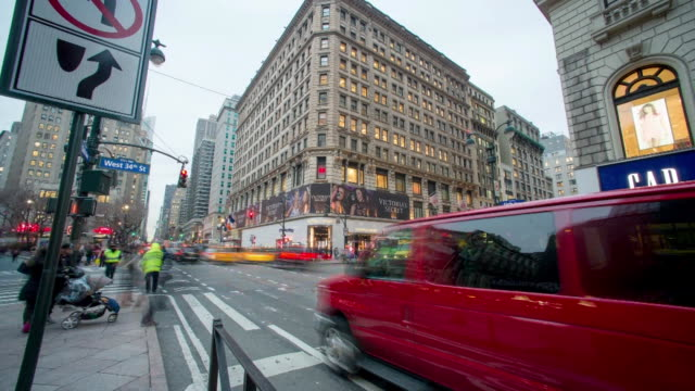 Time Lapse Shots of commuters and shoppers walking hurriedly through Herald Square in New York City on a cold winter day Shots pan across Herald...