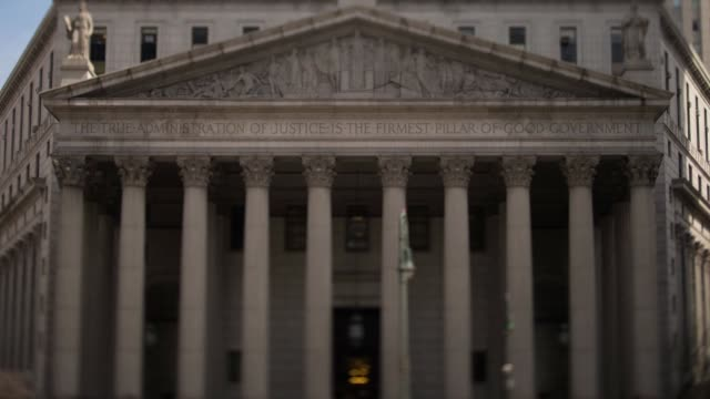 Time lapse shots of the State Supreme Court at 60 Centre Street in Manhattan New York US Sunlight moves across the columns lining the entrance to the...