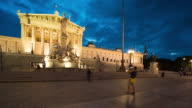 Time Lapse, Tourist waking at Austrian Parliament Building at dusk