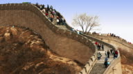 Time lapse tourists climbing and descending the stairs of the Great Wall at Badaling / China