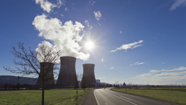Time Lapse tracking shot in front of nuclear plant
