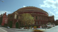 time lapse traffic in front of Royal Albert Hall / clouds in background / London, England