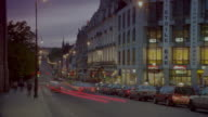 time lapse traffic on Karl Johan Street / Oslo, Norway / day to night