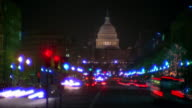 Time lapse traffic on Pennsylvania Avenue at night / U.S. Capitol Building in background / Washington D.C.