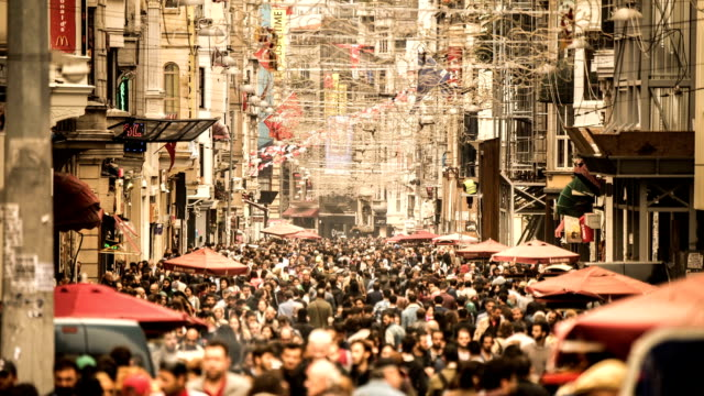 HD time lapse tram and crowded people at istiklal avenue