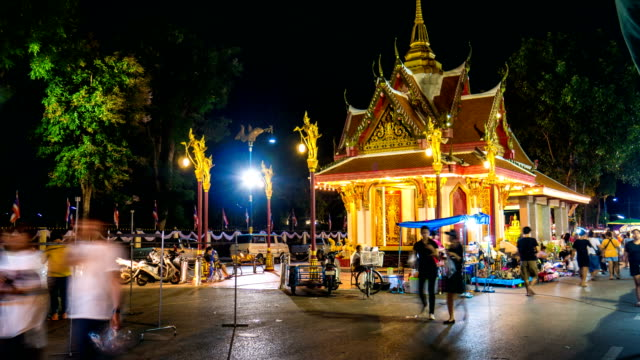 Time Lapse Video of Night Street Market and People Activity with Illuminated Colorful Shrine