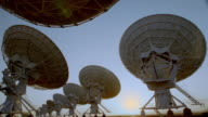 time lapse VLA (Very Large Array) radio telescope dishes / sunset to night / New Mexico