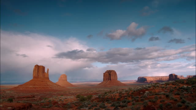 Time lapse wide shot clouds passing over Monument Valley on the Navajo Reservation / Southwest USA