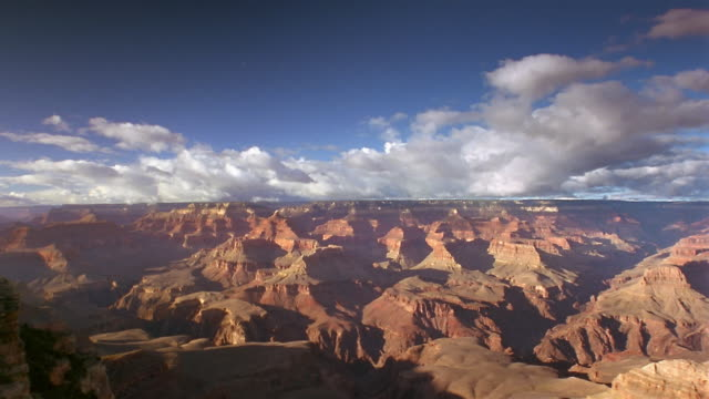 Time lapse wide shot pan thick clouds rolling over Grand Canyon / Arizona