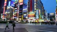 Time lapse wide shot pedestrians+ traffic in East Shinjuku Crossing / Tokyo, Japan