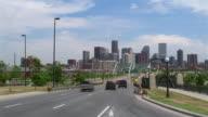 Time lapse wide shot traffic moving into city/ Denver, Colorado