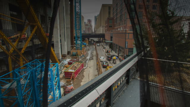 Time lapse workers working on a construction site
