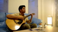 Time lapse Young man playing guitar relax after time out