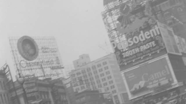 WS PAN TU TD Time Square streets are crowded with cars and people