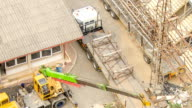 HD Time-lapse: Aerial view of working truck in electrical Construction site