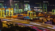 time-lapse: aerial warehouse Port background in Singapore at night