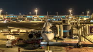 4K Time-Lapse: Airplane Arrive and depart from Jetway Dock night