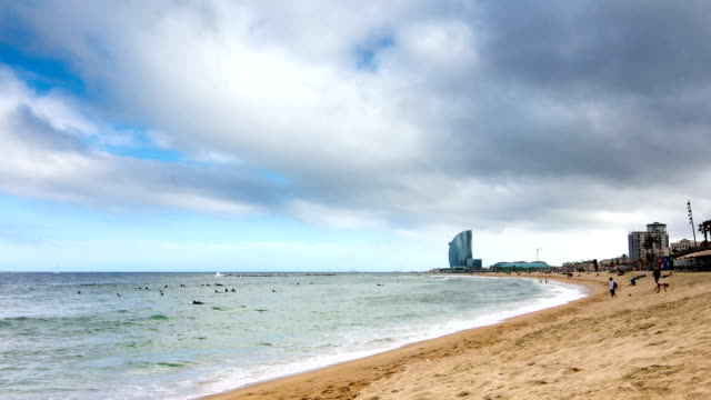 HD Timelapse Barcelona's main beaches with surfers and great clouds