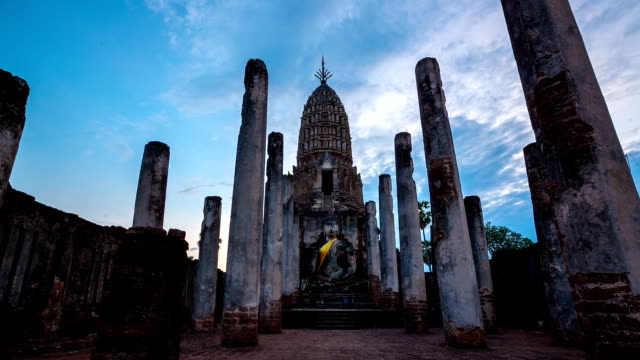 Time-lapse: Big buddha in Sukhothai historical park Thailand sunset