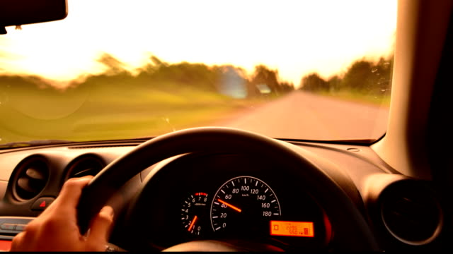 Time-lapse, Car driving at sunset