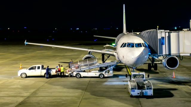 HD Time-lapse: Cargo loading air freight logistic at night