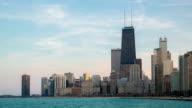 HD Time-lapse: Chicago Skyline along Michigan Lake at dusk USA
