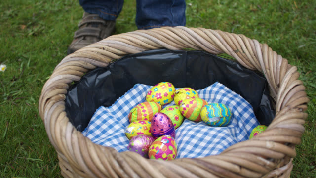 Timelapse children collect chocolate during Easter egg hunt, UK