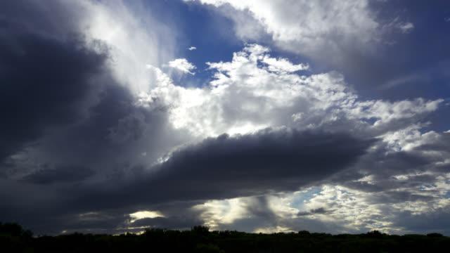 'Timelapse clouds scud overhead as sun sets, South Africa'