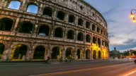 Timelapse: Colosseum at sunset with colorful traffic lights, Rome - Italy.