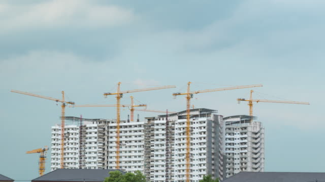 4K Timelapse: Cranes in construction of tall buildings
