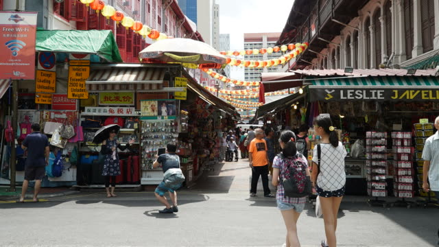 Timelapse crowded people in china town at singapore
