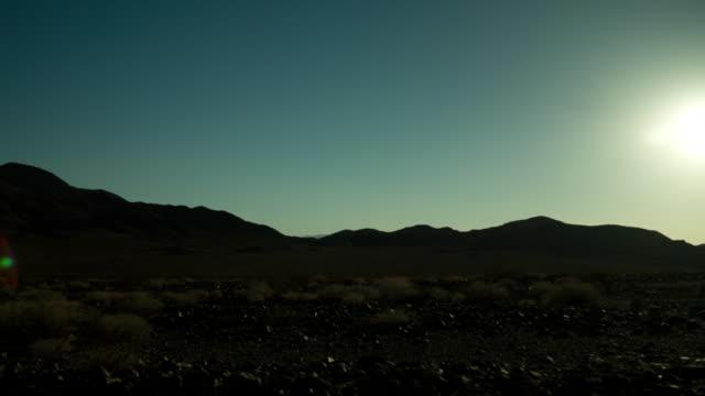 Timelapse day to night mountainous desert with stars