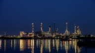 Timelapse day to night oil refinery