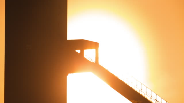 Time-Lapse Extreme Close up shot of sun setting over of Alpensia Ski Jumping Stadium in Pyeongchang (2018 Winter Olympics)