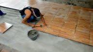 Time-lapse footage of floor tiling