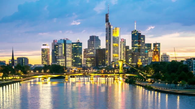 4K Time-lapse: Frankfurt Cityscape along the main river at dusk