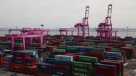 Timelapse gantry cranes move among stacked shipping containers at the Sun Kwang Newport Container Terminal in Incheon New Port in Incheon South Korea...