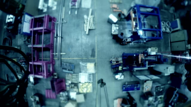 Timelapse manufacturing staff in production factory.