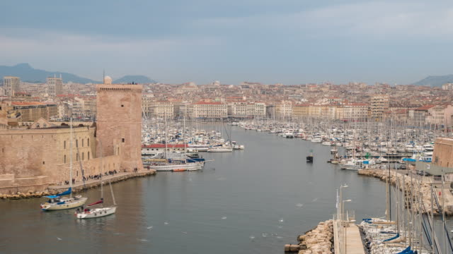 Time-lapse: Marseille city with old Vieux Port sunset