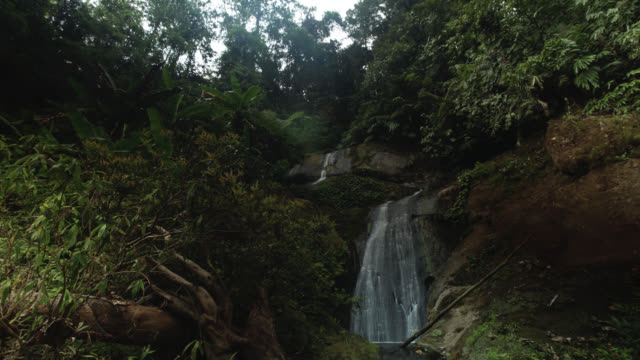 Timelapse nightfall over rainforest waterfall, Htamanthi, Myanmar