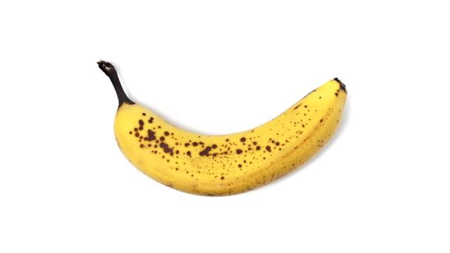 Time lapse di una banana danneggiati, sfondo bianco