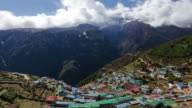 Time-lapse of a colorful village on a Himalayan mountainside.