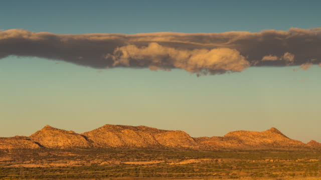Timelapse of Clouds Over Low Hills at Sunrise, Arizona Desert.