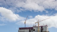 Time-lapse of construction crane and worker of building industry with blue sky , Zoom in movement