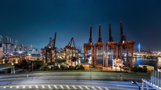 timelapse of cranes at the hong kong container port