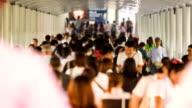 Timelapse of Crowd people walking on the Bridge walkway