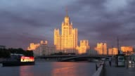 Timelapse of cruise boats sailing along the Moscow river near the Kotelnicheskaya embankment building in Moscow Russia on Wednesday July 5 2017