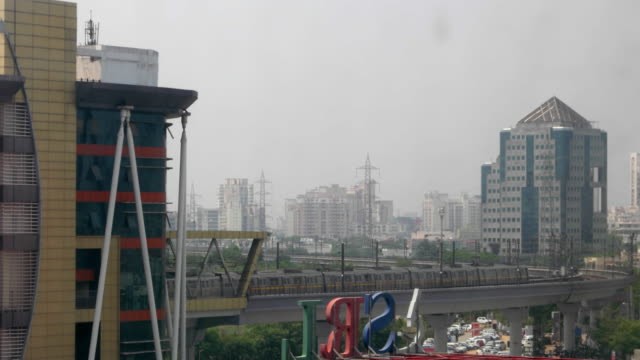 A time-lapse of Delhi Metro trains, on the elevated corridor of the yellow line, entering and exiting from the terminal station of HUDA City Centre in Gurgaon