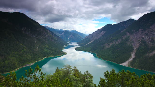 timelapse of dramatic sky and lake plansee, tirol, austria
