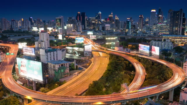 Time-lapse of Express way at bangkok city cityscape at night time , day to night time-lapse , Road way in bangkok city